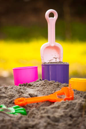 Child playground of sand with beach toys photo