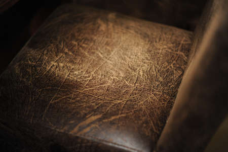 old furniture: Old textured leather chair closeup