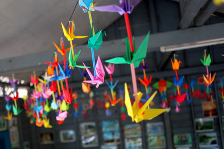 Colorful origami flying in room