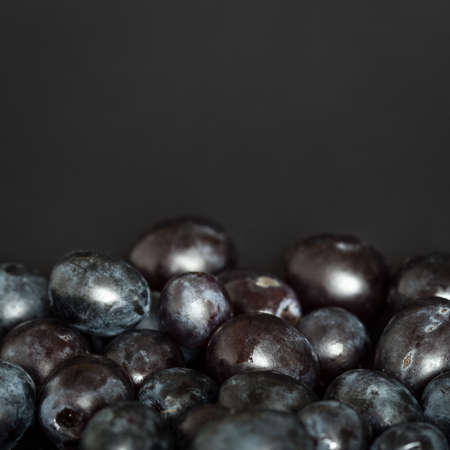 Grains of red grapes arranged in a way to create copyspace Stock Photo