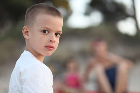 prudent: Young boy looking serious portrait Stock Photo
