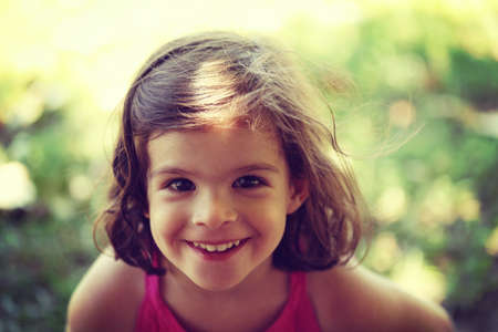 Young girl smiling and looking in to camera