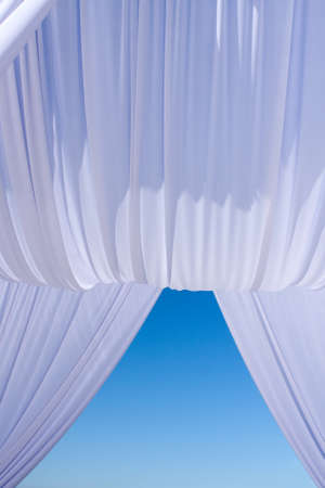 Wedding canopy in white on blue sky