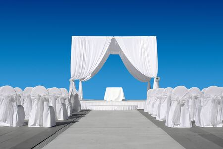Wedding canopy with chairs, all in white on blue sky