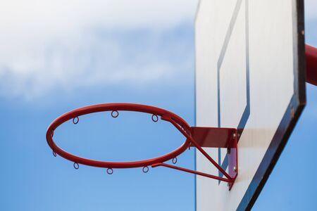 Basketball basket outdoor on blue sky