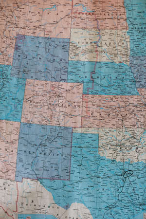 Old vintage map of the Plain States mounted on a wall. Selective focus, background blur and foreground blur