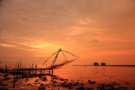 chinese fishing nets: Chinese fishing nets of Kerala during dusk hours. Stock Photo