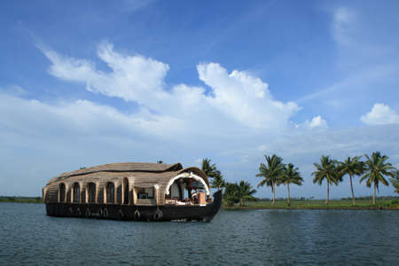 houseboat: A houseboat cruises on the backwaters of Kerala, India Stock Photo