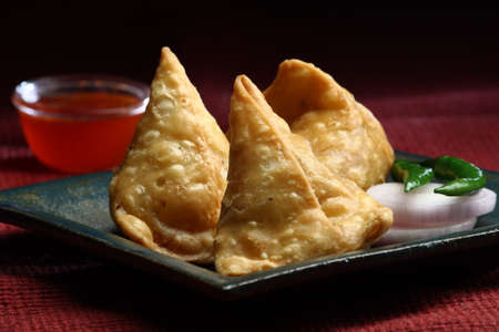 samosa: Fresh Indian Samosa with green chilli and onion slices