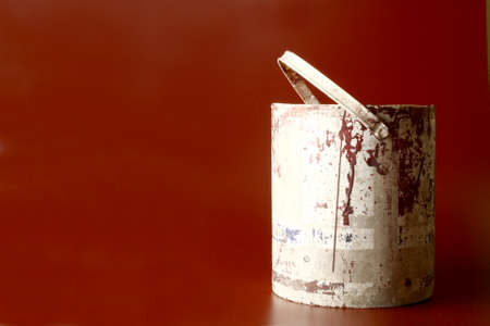 brownish: Old used bucket in a brownish red background Stock Photo