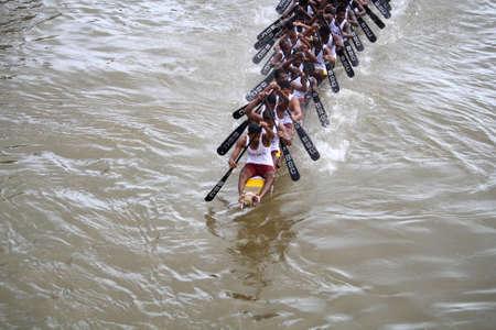 KOTTAYAM, INDIA - AUGUST 29, 2010 - Snake boat teams participate in the Thazhathangadi Boat race held in Kottayam, Kerala, India.