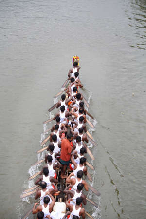 THIRUVALLA, INDIA - AUGUST 23 , 2010 - A Snake boat team participates in the Pumba Boat race held in Thiruvalla, India