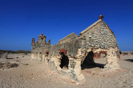 Remnants of the old Dhanushkodi church. Dhanushkodi was destroyed in a devastating cyclone in the year 1964 and popularly known as Ghost city. Stock Photo
