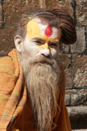 KATHMANDU - FEB 02,2014- An unidentified holy man stays at the Pashupathinath temple  in Nepal. Pashupathinath temple is an important Shiva shrine listed in the UNESCO World Heritage Sites