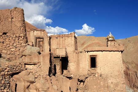 mud wall: Mud wall buildings of the old Basgo Monastery in Ladakh. Basgo is enlisted as an endangered heritage site by World Monument Foundation