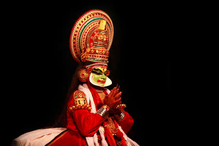 kathakali: THIRUVALLA, INDIA - NOV 05,2010- Kathakali artist performing in the stage for a temple festival  in Thiruvalla, Kerala, India. Kathakali is the traditional classical dance form of Kerala. Editorial