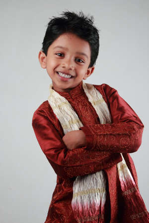 indian boy: Happy Indian boy wearing traditional dress