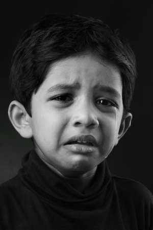 indian boy: Black and white image of a crying kid