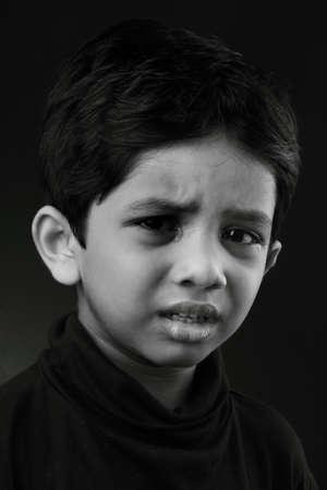 sad boy: Black and white image of a crying kid
