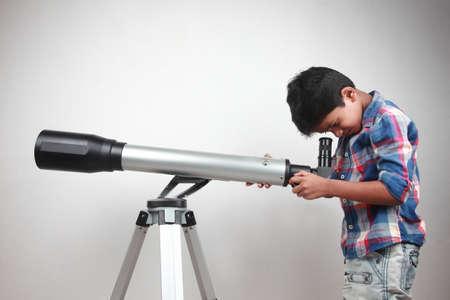 an eyepiece: Boy works on a telescope Stock Photo