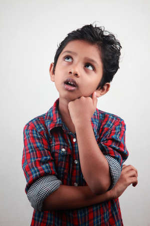 fear child: An anxious boy looking up Stock Photo