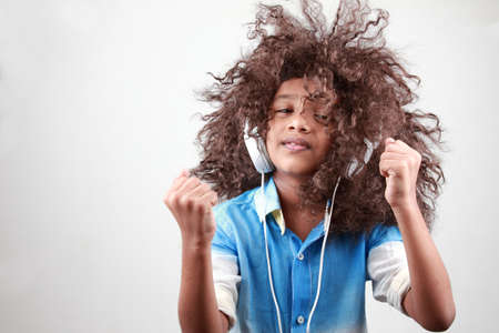 reggae: A boy with a funky hairstyle in a playful mood Stock Photo