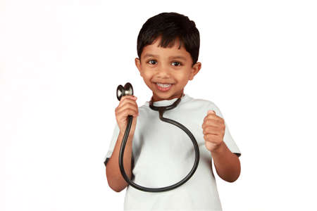 A boy with a stethoscope in a white background Stock Photo