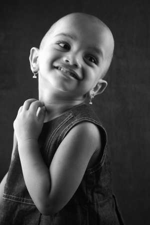 shaved head: Black and white portrait of an Indian girl child with shaved head Stock Photo