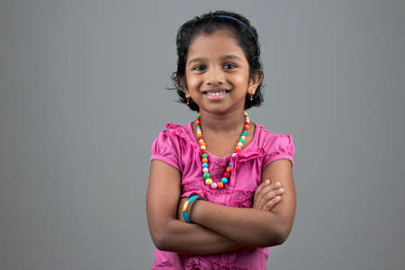 origin: Portrait of little girl of Indian origin with a smiling face