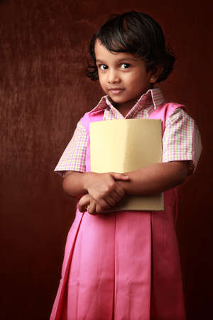 kid portrait: Portrait of a little girl in school uniform