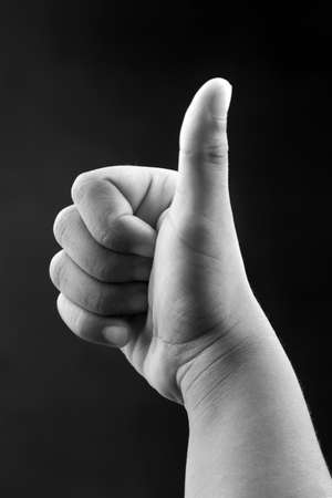 approbation: Monochrome image of hands of a kid showing okay gesture