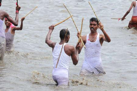 devotional: OCHIRA, INDIA - JUNE 17, 2015- Devotees take part in the Ochira Kali a ritualistic martial art festival played in the pond water at Ochira Parabrahma temple in Ochira , Kerala, India.
