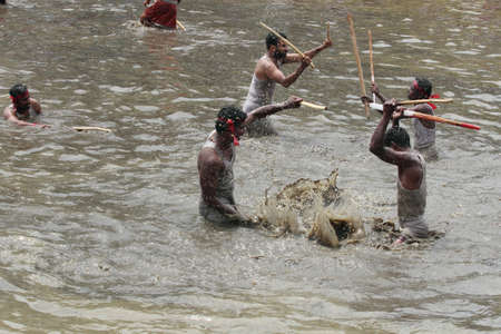 kali: OCHIRA, INDIA - JUNE 17, 2015- Devotees take part in the Ochira Kali a ritualistic martial art festival played in the pond water at Ochira Parabrahma temple in Ochira , Kerala, India.