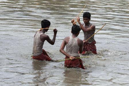 kali: OCHIRA, INDIA - JUNE 17,2015- Devotees take part in the Ochira Kali a ritualistic martial art festival played in the pond water at Ochira Parabrahma temple in Ochira , Kerala, India.