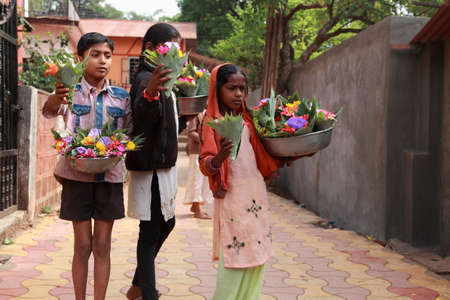 pune: PUNE, INDIA - APR 24,2011-Unidentified vendors sell flowers in front of a temple  in Pune, Maharashtra, India. Its custom ritual to offer flowers to deity in Hindu temples in India.