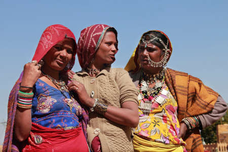 kalbelia: JAISALMER, INDIA - FEB 03, 2015-Unidentified tribal women dressed up in traditional Rajasthani costume and ornaments pose during Desert Festival in  Jaisalmer, Rajasthan, India. Editorial