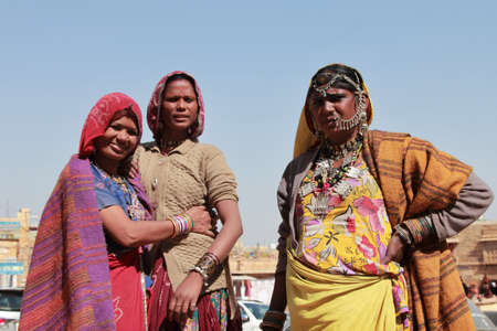 kalbelia: JAISALMER, INDIA - FEB 03,2015-Unidentified tribal women dressed up in traditional Rajasthani costume and ornaments pose during Desert Festival in Jaisalmer, Rajasthan, India.