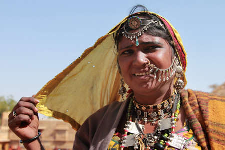 kalbelia: JAISALMER, INDIA - FEB 03,2015-Unidentified tribal woman dressed up in traditional Rajasthani costume and ornaments poses during Desert Festival  in Jaisalmer, Rajasthan, India.