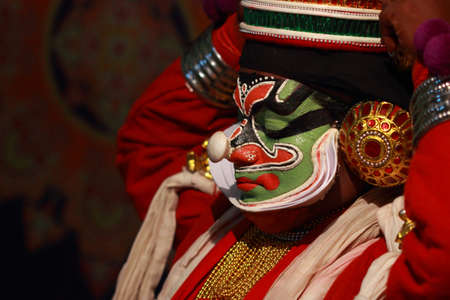 kathakali: ULLANNOOR, INDIA - FEB 11,2015- An unidentified Kathakali artist does make-up before the on-stage performance during a temple festival in Ullannoor, Kerala,India.