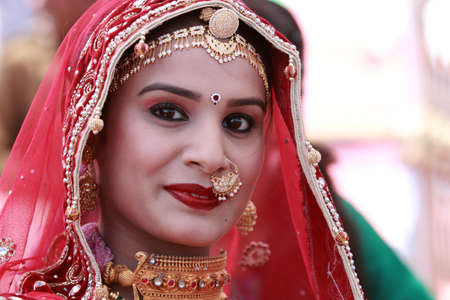 traditional   dress: JAISALMER, INDIA - FEB 01,2015-An unidentified Rajasthani woman participates in the Ms. Moomal contest conducted as part of Desert Festival held in Jaisalmer, Rajasthan, India. Editorial