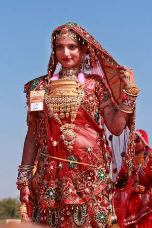 JAISALMER, INDIA - FEB 01,2015- An unidentified Rajasthani woman participates in the Ms. Moomal contest conducted as part of Desert Festival held in Jaisalmer, Rajasthan, India.
