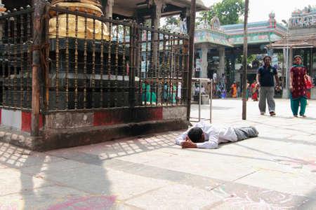 namaskar: CHENNAI, INDIA - FEB 09,2012-Hindu devotees performs Sashtanga Namaskar at Kapaleeshawar temple  in Chennai, India. Sashtanga Namaskar is an act of touching ones head on gods feet Editorial
