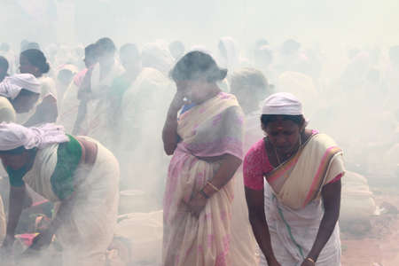 suffocating: ATTUKAL, INDIA - MAR 7,2012-Unidentified devotees take part in the Pongala ritual in Attukal,Kerala,India.The event is in Guinness records as the largest gathering of women in the world Editorial