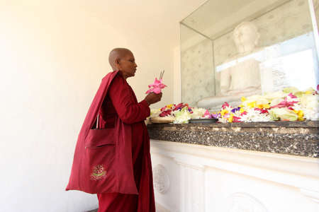 vihara: COLOMBO, SRI LANKA - DEC 11,2013- An unidentified Buddhist monk do prayers at the Kelaniya Raja Maha Vihara in Colombo, Sri Lanka. Editorial