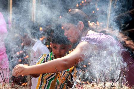 vihara: COLOMBO, SRI LANKA - DEC 11,2013- An unidentified Buddhist devotee burn incense sticks as a religious ritual at the Kelaniya Raja Maha Vihara in Colombo, Sri Lanka.