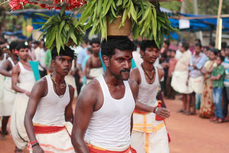 prevalent: MEZHUVELII, KERALA - MAR 03,2014-Ammankudam artists perform during the Shivaratri festival of Shiva temple in Mezhuveli, Kerala. Ammankudam is a temple dance prevalent in South India. Editorial