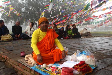 gautama buddha: LUMBINI, NEPAL - FEB 08,2014-A Buddhist monk does religious rituals in front of Mayadevi temple  in Lumbini, Nepal. Mayadevi temple is the birthplace of Gautama Buddha.