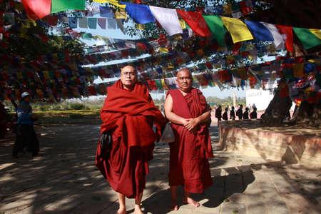 gautama buddha: LUMBINI, NEPAL - FEB 08,2014- Unidentified Buddhist monks visit Mayadevi temple in Lumbini, Nepal. Mayadevi temple, a UNESCO world heritage site, is the birthplace of Gautama Buddha. Editorial