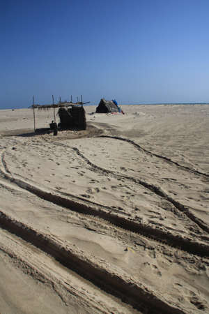tamilnadu: DHANUSHKODI, INDIA - OCT 06,2013-  Unidentified locals live in their temporary huts in Dhanushkodi, Tamil Nadu, India. Dhanushkodi suffered major damage in a devastating cyclone in 1964