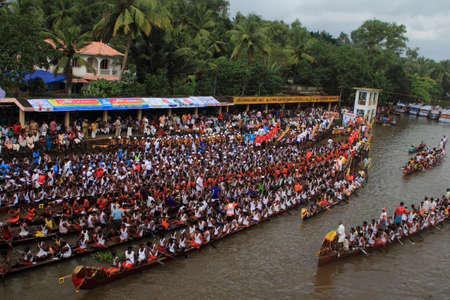 PAYIPPAD, INDIA - SEPT 18,2013-Snake boat teams line up to participate in the Payippad Boat race  in Payippad, Kerala, India. Boat races are the major sporting events in Kerala.